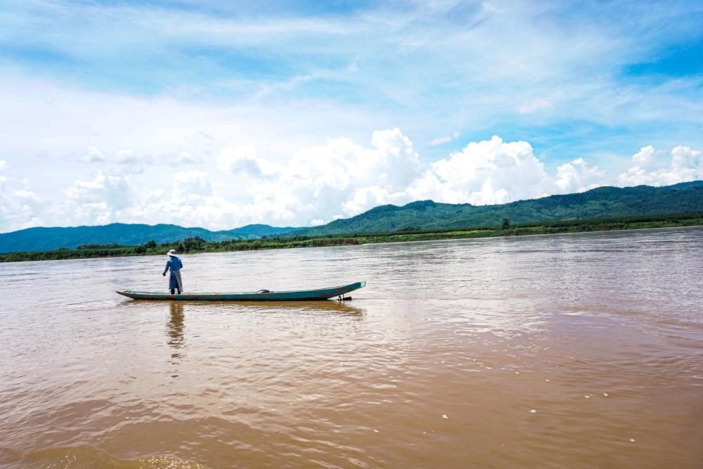 Laos slow boat fisherman